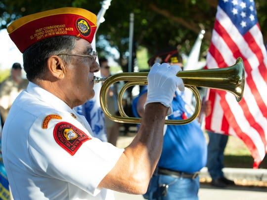 "Veteran Ray Rivera plays, ""Taps,"" on Sunday, May 27,"