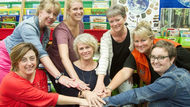 Hilton Elementary School teachers, after several pre-school-year meetings, show their team support Thursday, Aug. 31, 2017. From left are fourth grade teacher Pam Wikman, Jan Welter (third grade), Kim Lewicki (academic enrichment), Jenny Morley (fourth), Anne Michaels (fourth), Cindy Constantine (third) and Mary Beane (third grade).