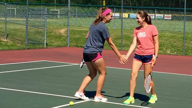 Doubles team Landon Aud and Emily Aleshevich at practice preparing for their doubles state match against Wise-Central on Friday.