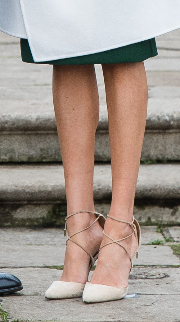 A closeup of her strappy heels.