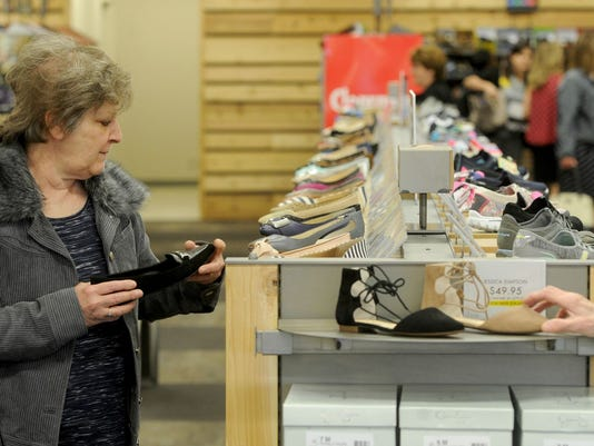 Karen Houck of Manchester Township shops at DSW at the West Manchester Town Center earlier this year. The shopping center will host a Plaza Party Saturday.