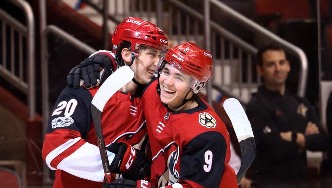Arizona Coyotes center Dylan Strome (20) celebrates with teammate Clayton Keller (9) after scoring the first goal of his NHL career in the third period against the New Jersey Devils at Gila River Arena.