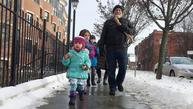Burlington resident Stuart Weiss walks down Main Street in Burlington with his visiting grandchildren in this December 2017 file photo.
