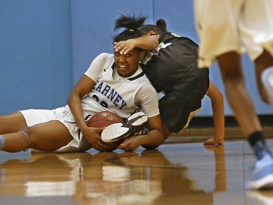 Bishop Kearney's Allure Simmons, left, looks for help after stealing the ball from Athena's Bria Wilson during their game at Bishop Kearney in Irondequoit Friday, Feb. 19, 2016.