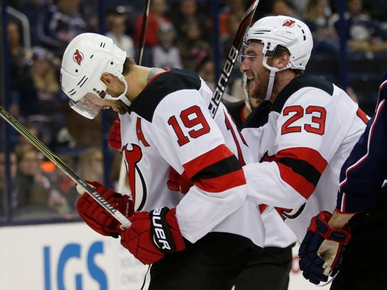 New Jersey Devils forward Travis Zajac, left, and teammate