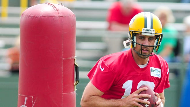 Green Bay Packers quarterback Aaron Rodgers runs through drills during OTA practice at Ray Nitschke Field, Tuesday, June 10, 2014. H. Marc Larson/Press-Gazette Media