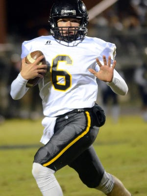Hendersonville High sophomore quarterback Brett Coker carries the football during the third quarter of Friday evening's 38-7, season-ending loss at Independence in a Class 5A second-round playoff game.