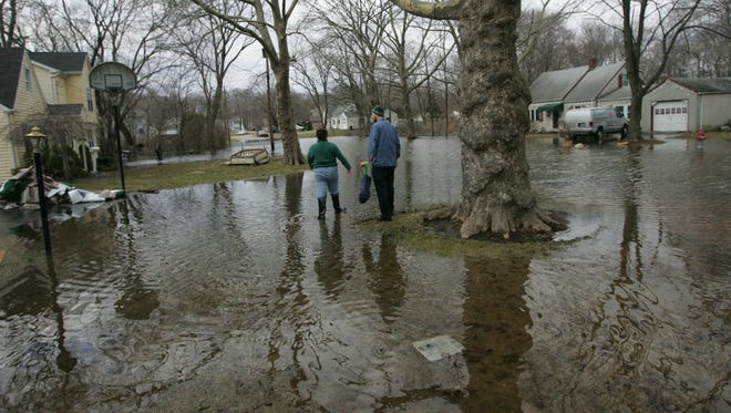 Residents on Village Road in Pequannock after the floods in March 2011.
