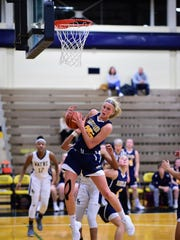 Pulling down a rebound for Hartland during Monday's KLAA tournament semifinal is sophomore Whitney Sollom (25).