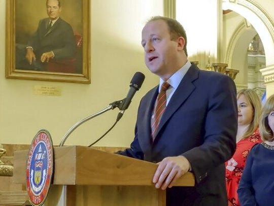 Colorado Gov. Jared Polis speaks at the state Capitol