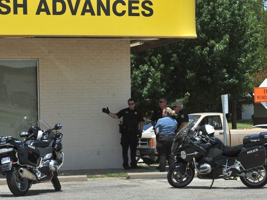 Wichita Falls police work the scene of an armed robbery