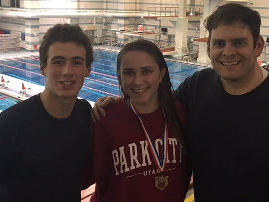 State qualifying divers Noah Vigran, left, and Annie Garretson also sing for Indian Hill choir director Jeff Clark.