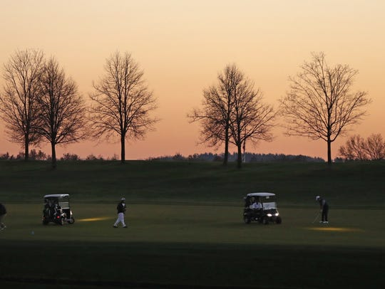 In this Nov. 18, 2016, file photo, golfers use the