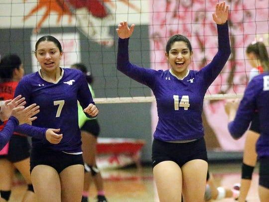 Andrea Gandarilla, 14, and Savannah Marenco, 7, celebrate