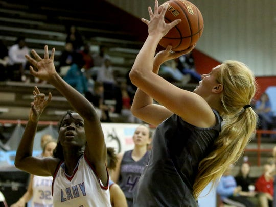 Jacksboro's Jaynee Yourt goes for two-points against