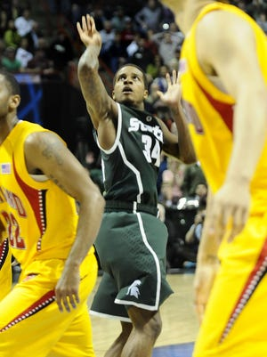 Michigan State's Korie Lucious watches as his  three-point shot at the buzzer beat Maryland, 84-83, in Spokane, Wash., on March 21, 2010.