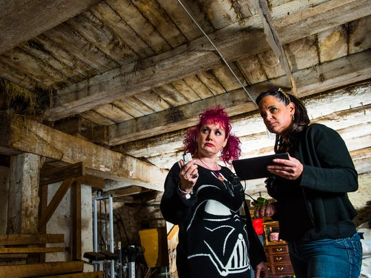 """Two members of the Gettysburg Ghost Gals, Jenny Thomas (left) and Brigid Goode, pose for a portrait during a 2016 investigation at a farm in Gettysburg. An investigation of another site near Gettysburg will be shown Nov. 22, 2019 on the Travel Channel show """"Ghost Nation."""""""