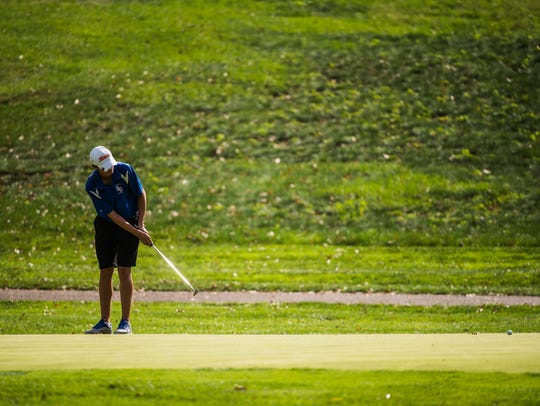 Spring Grove's Brandon Simmons puts toward the hole