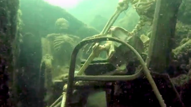 In this frame from video provided by the La Paz Sheriffs' Office, fake skeletons are strategically placed to appear as if they were sitting together with their lawn chairs bound to large rocks in the Colorado River near the Arizona and California border.  A Phoenix couple has claimed responsibility for the two fake skeletons.  The husband and wife approached the La Paz County Sheriff's Office earlier this week and brought a photo as proof they were behind the prank in Parker, Ariz. Lt. Curt Bagby says there are no plans to press charges and considers the incident harmless.