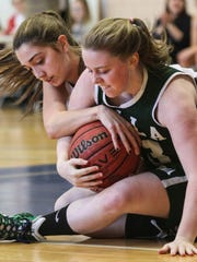 Villa Walsh's Mary Walsh and St. Elizabeth's Ellie Martine battle for the ball during a girls basketball game at College of Saint Elizabeth in Florham Park on Saturday.