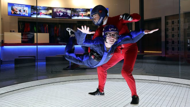 Reporter Kevin Phelan tries indoor skydiving with the help of instructor Chris Dixon at iFly at Ridge Hill in Yonkers, Dec. 21, 2015.