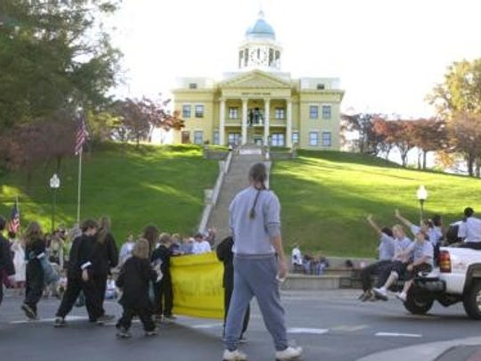 The parade for Sylva's 150th Anniversary goes by the famous old Jackson County Courthouse in 2001.