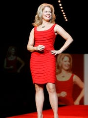 "FILE - In this Friday Feb. 2, 2007 file photo, Mary Hart of ""Entertainment Tonight,"" wearing a dress by designer Carmen Marc Valvo, walks the runway during the Red Dress Heart Truth fashion show during Fashion Week in New York. Hart's legacy in entertainment news will be recognized Sunday, April 30, 2017 with a lifetime achievement award at the Daytime Emmys ceremony."