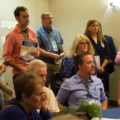 Democratic delegates from Vermont huddle for instructions at a hotel Monday morning as they prepare for the first day of the Democratic National Convention, expecting to hear a speech by Vermont Sen. Bernie Sanders later in the day.