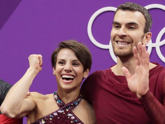 Meagan Duhamel and Eric Radford of Canada react as their scores are posted following their performance in the pairs free skate figure skating final in the Gangneung Ice Arena at the 2018 Winter Olympics in Gangneung, South Korea, Thursday, Feb. 15, 2018. (AP Photo/Julie Jacobson)