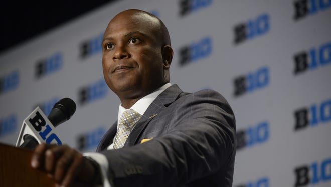 """""""I think it will help the kids out immensely,"""" Purdue coach Darrell Hazell says of cost-of-attendance scholarships. """"Especially the (national) guys who know they're going to be able to afford a plane ticket, transportation home. That's a lot of additional money."""""""