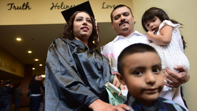 Chantel Marquez is pictured with her husband, Hugo Sandoval, and their two children, Eliseo and Ellice Sandoval, after attending her graduation ceremony Saturday, Oct. 1, 2016, for ITT Technical Institute's Breckinridge School of Nursing at the Mt. Scott Church of God in Portland. Last month, ITT Technical Institute announced that it would cease operating educational services which it has offered for more than half a century.