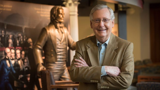 Senate Majority Leader Mitch McConnell, with a statue of Kentucky Sen. and House Speaker Henry Clay at the University of Louisville.