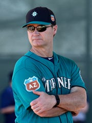 Seattle Mariners manager Scott Servais watches a drill during spring training baseball practice, in Peoria, Ariz. From the chair of new general manager Jerry Dipoto, to first-time manager Scott Servais and down to the 25th man on the bench, Seattle is essentially an entirely new team.