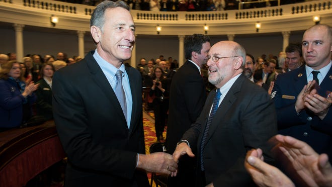 Vermont Gov. Peter Shumlin, left, is greeted as he enters the House chamber before delivering the State of the State Address on Thursday in Montpelier.