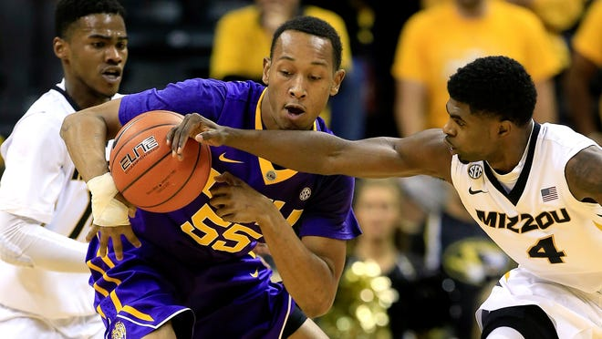 Missouri's Tramaine Isabell (4) knocks the ball loose from LSU's Tim Quarterman (55) during a game at Mizzou Arena on Jan. 8 in Columbia, Missouri. Quarterman has provided instant production off the bench for the Tigers this season.