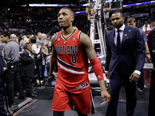 Portland Trail Blazers' Damian Lillard (0) walks off the court following the team's loss in Game 5 of a Western Conference semifinal NBA basketball playoff series.