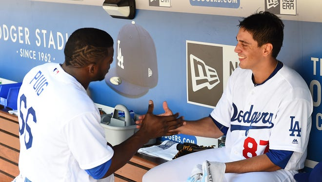 The Los Angeles Dodgers hope a rejuvenated Yasiel Puig, left, and top minor league pitching prospect Jose De Leon will give them a playoff push in September.