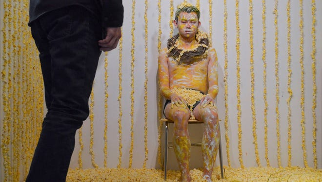 Iowa City artist Kong Chun Yeep did his paint-and-popcorn performance at the Public Space One gallery in Iowa City. He plans to repeat the act Thursday at CSPS Hall in Cedar Rapids.