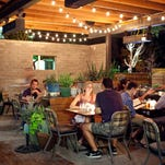The main patio area at Ocotillo has a beer garden vibe with plenty of seating and its own bar.