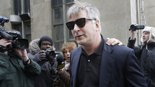 In this Tuesday, Nov. 12, 2013 file photo,  actor Alec Baldwin leaves criminal court in New York. Police in New York City say actor Alec Baldwin has been arrested for riding a bike the wrong way on the street and acting belligerently toward the arresting officers. Police say the ?30 Rock? star was taken into custody Tuesday, May 13, 2014. They say two officers noticed him riding his bicycle the wrong way on 16th Street near Fifth Avenue near Union Square Park. (AP Photo/Seth Wenig, File)