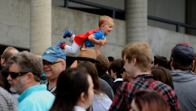 One-year-old Adam Jorgensen gets a birds-eye view of the crowd Sautrday during Pensacon 2017 at the Pensacola Bay Center.