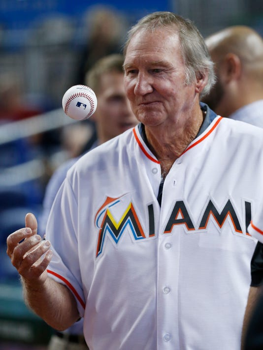 In this July 14, 2017, photo, former Florida Marlins player Charlie Hough, who threw the first pitch ever in a Marlins game, prepares to throw out a ceremonial first pitch before the start of a baseball game between the Miami Marlins and the Los Angeles Dodgers in Miami. The knuckleball has always been a bit of oddball, the butt of jokes, the object of endless curiosity, a talismanic pitch understood by only a few. It could soon be extinct in the big leagues, and that would be quite a shame. (AP Photo/Wilfredo Lee)