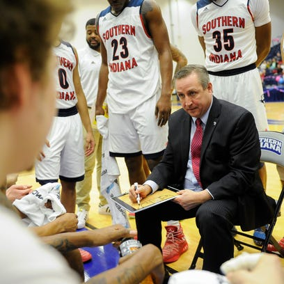 Southern Indiana head coach Rodney Watson gives instructions