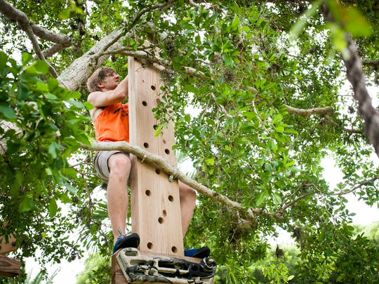 """Naples resident Garrison Kalvin trains on a homemade course to prepare for the upcoming season of """"Team Ninja Warrior: College Edition"""" on Tuesday, Aug. 9, 2016. Garrison Kalvin is part of the climbing club at the University of Florida, where he is in his third year and has been training for the popular NBC TV series, which will feature five episodes for college athletes."""