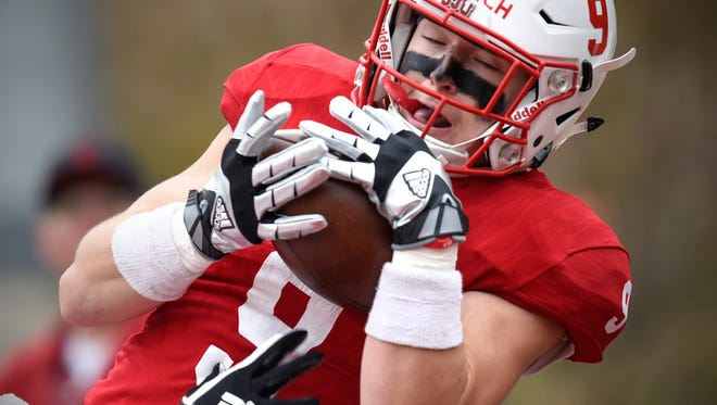 St. John's wide receiver Will Gillach leaps to make a touchdown pass last Oct. 21 in Collegeville. Gillach had two touchdown receptions in the Johnnies' season-opening win over Wisconsin-Stout.