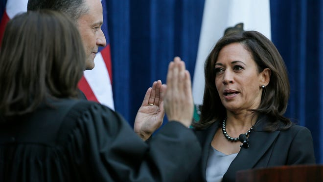 California Attorney General Kamala Harris takes the oath of office in January.