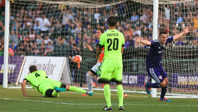 Louisville City's Chandler Hoffman celebrates after scoring the team's first goal early in the second half against Charleston Saturday night.
