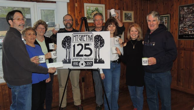 Shown at the conclusion of the event are members of the winning team. From left, Bob Rader, Kristi Donahue, Penny Shoop, Brent Walley, Don Miller, Carole Miller, Kathy McKenna and Larry Mckenna.
