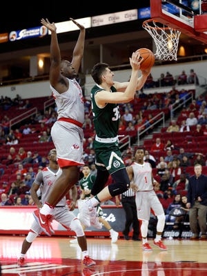 CSU's Nico Carvacho gets past Fresno State's Terrell Carter to shoot a layup in a Jan. 18 game in Fresno, Calif. Carvacho's success pulling down offensive rebounds in recent games has made him a more confident shooter.