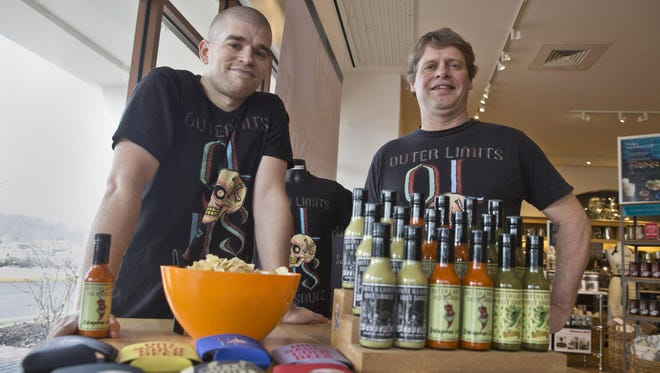 Ed Martin IV and his father Ed Martin III of Long Branch with Outer Limits Hot Sauce products during an event at Williams-Sonoma.
